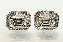 A pair of 18ct white gold and diamond halo cluster earrings the emerald cut diamonds,