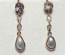 A pair of Edwardian gold, diamond and pearl drop earrings the hoops set with a single 0.25 carat old cut diamond,
