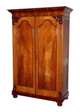 A good Channel Islands flame mahogany linen press mid-19th century, the flared,