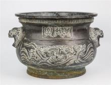 An Oriental bronze jardinière 19th century, everted rim above collar of miniature roundels,