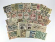 A collection of international banknotes early 20th century, to include German banknotes, Russian 10,000 Rouble 1919 note etc. (33)