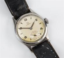 A gentleman's Omega stainless steel wrist watch 1940s-50s, the 25mm. silvered dial signed 'Omega Swiss Made',