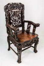 A 19th century Chinese carved hardwood dragon armchair the pierced panelled back well carved with dragons chasing a flaming pearl am...