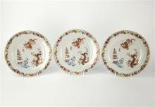 A set of three late 18th century Chinese export plates enamel decoration, borders with trailing sequence of stylised emblems,