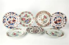 Four late 18th / early 19th century Chinese export famille rose plates bearing floral enamel decoration; together with three Chinese...