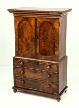 An apprentice piece mahogany linen press 19th century,