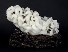 A fine Chinese white jade finger citron spill vase or brush holder 20th century, the main body carved intricately as the pierced,