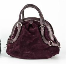 A Salvatore Ferragamo handbag purple suede arched top handbag, leather hoop handles on adjustable buckle straps, zip top,