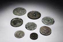 A GROUP OF EIGHT ARCHAIC BRONZE MIRRORS