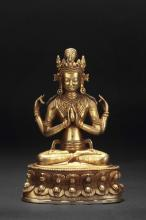 A GILT BRONZE FOUR-ARMED AVALOKITESVARA