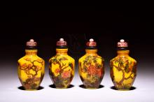 SET OF FOUR YELLOW GLASS 'FLOWERS' SNUFF BOTTLES