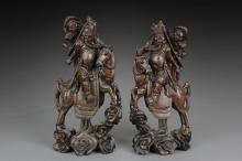 A PAIR OF HARDWOOD 'GUANGONG' CARVINGS WITH SILVER LINES INSET
