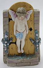 KPM Floral Planter Cherub Pinned to a Garden Gate