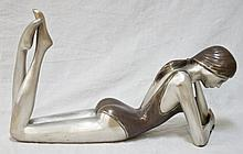 Bronze sculpture of a Woman Laying in Bathing Suit