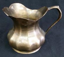 antique brass water pitcher