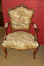 Meuble: Paire de fauteuils cabriolets de style Louis XV en noyer sculpté milieu 19eS assise manchettes et dossier tissu décor de personnages et végétaux