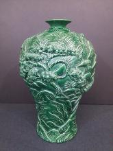 A Qing green glazed carved porcelain vase- Qianlong period carved seal mark