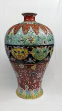 A Qing heavy porcelain meiping floor vase with vibrant decoration