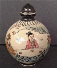 A famille rose snuff bottle round shaped and marked