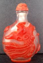 A peking glass snuff bottle carved dragon and phoenix