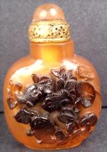 A peking glass snuff bottle with fish and lotus