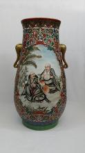 A Qing large yangcai porcelain Lohan vase