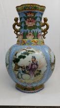 A large porcelain vase of baluster lobed form lotus design