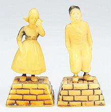 Lot of 2: Celluloid Figural Tape Measures.