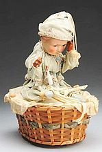 Mechanical Doll in Basket.