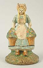 Cast Iron Girl with Baskets of Flowers Doorstop.