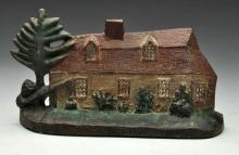 Cast Iron Hiram Powers Cottage Doorstop.
