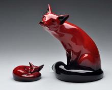 Pair Of Royal Doulton Red Flambe Foxes.