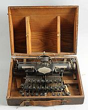 Typewriter in Original Wood Carrying Case.
