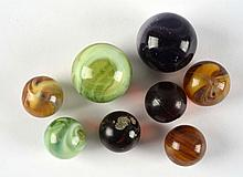 Lot of 8: Bullet Mold Marbles.