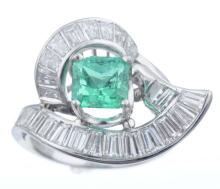 A Emerald And Diamond Ring.