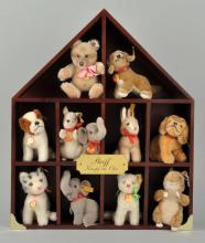 Lot of Steiff Animals In Display Box.