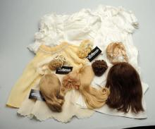 Lot Of Doll Dresses And Wigs.