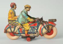 Argentine Man & Woman on Motorcycle Toy.