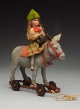 Doll on Horse Pull Toy.
