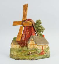 Cast Iron Windmill with Cottages Doorstop.