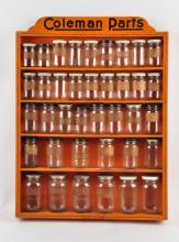 Coleman Wooden Parts Cabinet with Bottles.