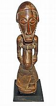 CARVED WOODEN FIGURE FROM BASSI KASSINGO PEOPLE