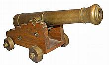 BRASS AND WOOD DECORATIVE CANNON.