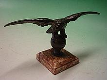 A Bronze Desk Weight. Formed as an eagle with spre