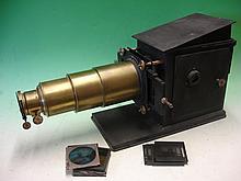 A Brass and Tinplate Magic Lantern with rackwork f