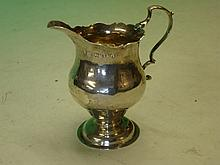 Silver Cream Jug of helmet form with double scroll
