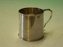 A Silver Mug. The slightly tapered body with reede