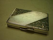 A Silver (835) Card Case^ Engine turned and chased