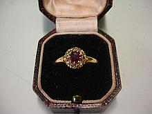 A Ruby and Diamond Cluster Ring in 18ct gold