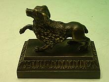 A Bronze Desk Weight formed as a poodle on a mould